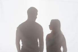 picture of wife-beater  - Silhouette of man and woman standing on white background and looking at each other - JPG