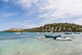 image of ski boat  - Small boats and jet skis anchored bya tropical luxury resort - JPG