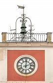 picture of roman numerals  - Old tower clock with Roman numerals and bells on top - JPG