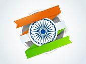 image of ashoka  - Shiny Ashoka Wheel with national tricolor paper stripes for Indian Republic Day celebration - JPG