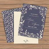 stock photo of announcement  - Wedding invitation cards with floral elements on wood plank background - JPG