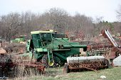 picture of junk-yard  - A rusted tractor waits at the scrap yard to be recycled - JPG