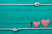 picture of candy cane border  - Red and white candy cane striped hearts - JPG