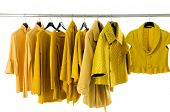 stock photo of clothes hanger  - female yellow clothing on hangers  - JPG