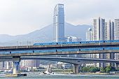 stock photo of hong kong bridge  - high speed train on bridge in hong kong downtown city at day - JPG