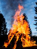 pic of bonfire  - Outdoor bonfire with giant logs and blaze - JPG