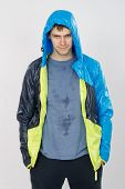 picture of wet pants  - thirty young athletic man does physical exercises - JPG