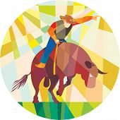 pic of bull-riding  - Low polygon style illustration of rodeo cowboy pointing riding bucking bull set inside a circle - JPG