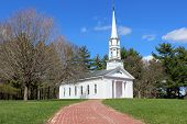 foto of mary  - A white clapboard New England Chapel in Springtime.