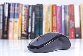 foto of online education  - Computer mouse with focus with books in background - JPG