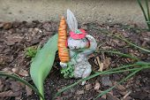 pic of figurines  - Spring Bunny Figurine Stands Guard in the Garden - JPG