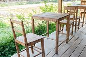 foto of lawn chair  - wooden table and chair on the terrace with the garden view - JPG