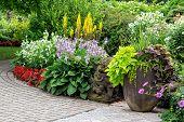 pic of interlocking  - Detail of a beautiful summer garden with an interlocking stone walkway - JPG