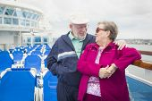 foto of passenger ship  - Happy Senior Couple Enjoying The View From Deck of a Luxury Passenger Cruise Ship - JPG