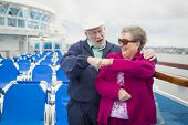 image of passenger ship  - Happy Senior Couple Fist Bump on the Deck of a Luxury Passenger Cruise Ship - JPG