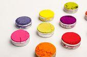 foto of holi  - Colorful Indian Holi festival dyes on white background - JPG