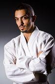 foto of karate  - Karate player in dark room - JPG