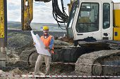 stock photo of piles  - Mechanic engineer checking road plans in front of drilling pile foundation - JPG