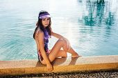 picture of hot-weather  - Young pretty fashion sport woman posing outdoor in summer on tropic island in hot weather in bikini on pool party - JPG