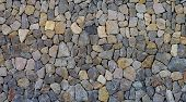 stock photo of cobblestone  - Background of Sharp Grey and Beige Cobblestones closeup Outdoors - JPG