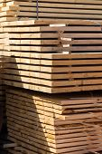 stock photo of edging  - big pile of lumber edge board for the construction site - JPG