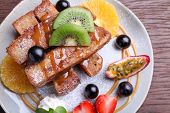 pic of french toast  - French toast with fresh fruitcloseup on a wood table - JPG