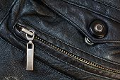 picture of stud  - zipper and press stud in old black leather close up - JPG