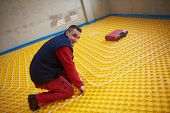 image of convection  - group of workers installing underfloor heating and colling in modern home - JPG