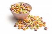 stock photo of cereal bowl  - colorful cereal rings in bowl on white background - JPG