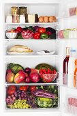 foto of food pyramid  - Refrigerator full of food isolated on a white background - JPG