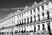 picture of victorian houses  - Black and white monochrome photograph picture of  expensive old fashioned typical Regency Georgian terraced town houses building architecture in fashionable London - JPG
