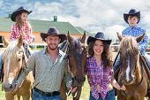 picture of western saddle  - cowboy family of four with horses closeup - JPG