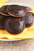 stock photo of sponge-cake  - Jaffa cakes a sponge base cake with a layer of orange flavoured jelly coated with dark chocolate - JPG