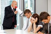 foto of boredom  - Young confident caucasian businessman screaming on his employee - JPG