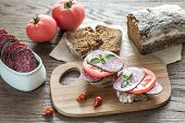 pic of tomato sandwich  - Sandwiches With Salami And Tomatoes On The Wooden Board - JPG