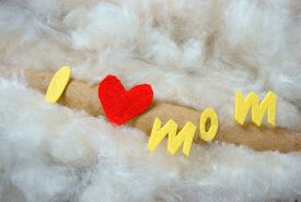 image of i love you mom  - Happy mothers day i love you mom message idea from colorful fiber letter red heart on white cotton background abstract concept mother - JPG