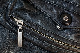 picture of zipper  - zipper and press stud in old black leather close up - JPG
