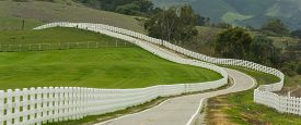 picture of long winding road  - Country road with long white picket fence - JPG