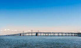 stock photo of maryland  - Chesapeake Bay Bridge in Maryland near sunset - JPG
