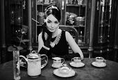 Постер, плакат: Beautiful Girl At The Image Of Audrey Hepburn