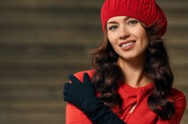 stock photo of beret  - Portrait of a beautiful young woman with background stairs outdoors - JPG