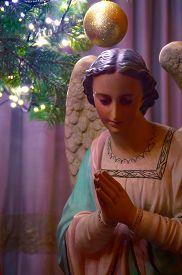 image of christmas angel  - Artistic vintage dark soft focus edit of a christmas angel under a christmas tree  - JPG