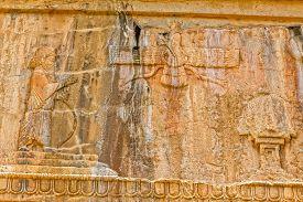 stock photo of zoroastrianism  - Faravahar Royal tombs facade detail of the Zoroastrianism - JPG