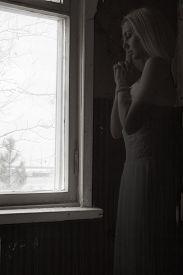 stock photo of wraith  - Photo of a Praying ghost near the window - JPG