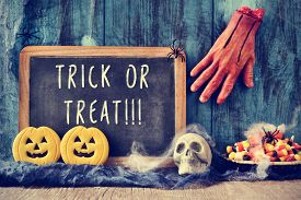 picture of amputation  - a chalkboard with the text trick or treat written in it in a dismal scene with an amputated hand - JPG