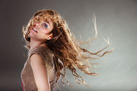 pic of hair motion  - Mysterious enigmatic woman in studio on grey - JPG