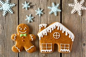 picture of gingerbread man  - Christmas homemade gingerbread man and house on wooden table - JPG