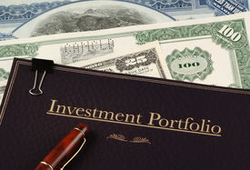 image of nyse  - investment portfolio on top of vintage stock and bond certificates - JPG