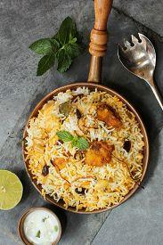 stock photo of raita  - Fish Biryani with Raita Basmati rice and Indian spices - JPG