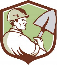 picture of spade  - Illustration of a construction worker wearing hard hat holding spade viewed from side set inside shield crest done in retro style - JPG